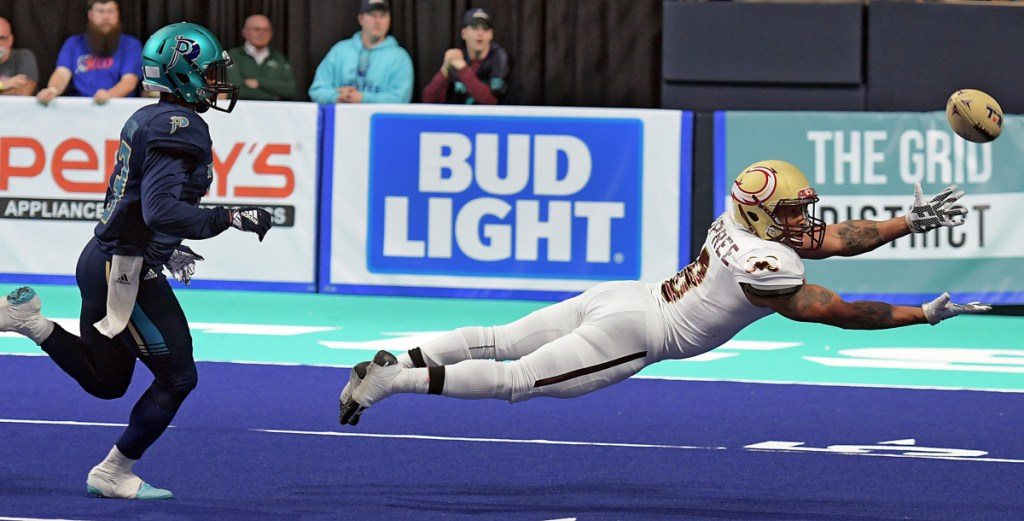 WORCESTER - Maine Mammoths Maurice Dupree makes a diving attempt at a catch as Massachusetts Pirates' Kiante Northington trails the play at the DCU Center, during the Pirates' National Arena League home opener, Saturday, April 7, 2018. [T&G Staff/Steve Lanava]