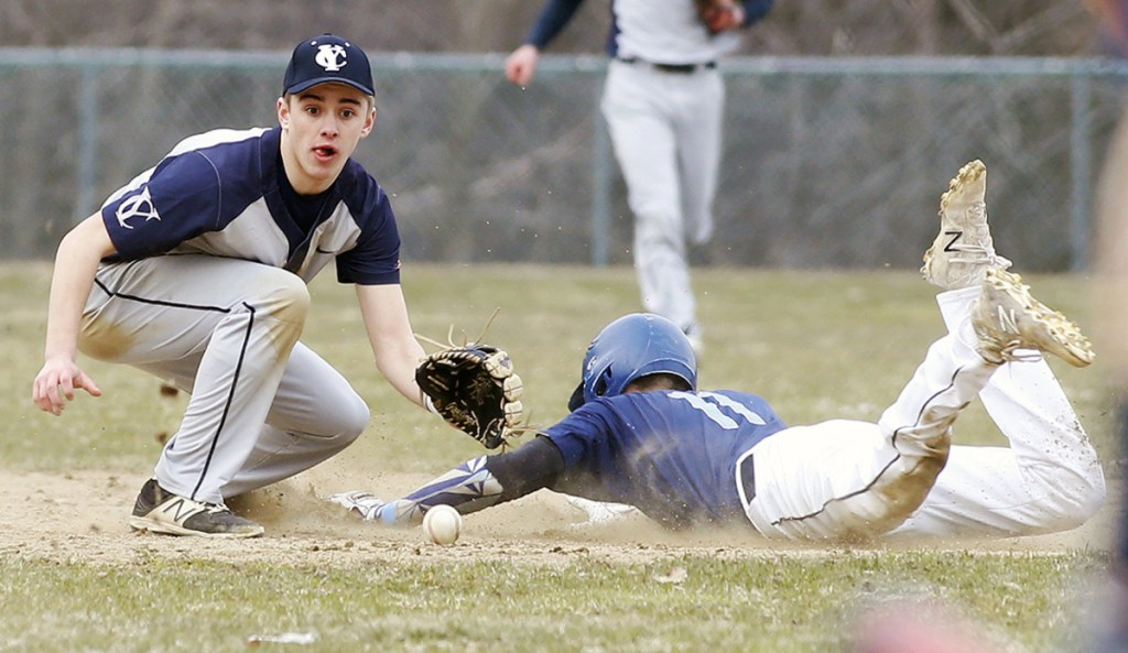 York's Tim McDonald slides safely into second while Yarmouth's Aidan Hickey awaits the throw during the season-opening game for both teams Thursday in Yarmouth. The Clippers rallied to a 4-3 win.