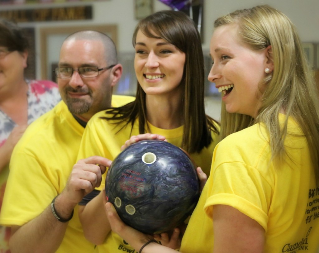 New Balance employees, from left, Matt LeBlanc, Alisha Whittemore and Ashley Dodge supported their bowling team and local youth at last year's Big Brothers Big Sisters of Mid-Maine Bowl for Kids' Sake event in Skowhegan. This year's event is May 2-10 in Skowhegan, Augusta and Hallowell.