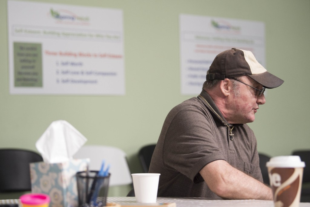 Kevin Horton sits at a table for a snack during an open house Thursday at the new National Alliance on Mental Illness peer recovery center in Waterville. The center offers support groups and classes to help those confronted by mental health or substance abuse challenges.