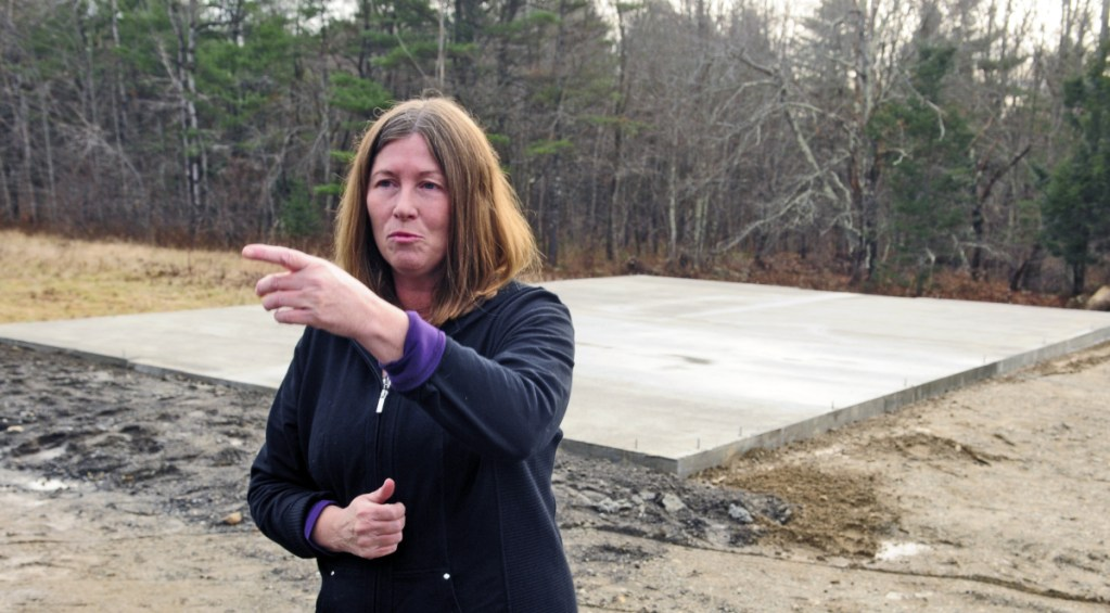 Standing in front of a foundation that was poured recently to enable construction of a barn for her cows at her Richmond home, Daria Goggins talks at Nov. 21, 2015, about finding her pair of Holsteins shot and killed a day earlier. Goggins said Friday she is increasing a reward for information on the case from $2,500 to $5,000.