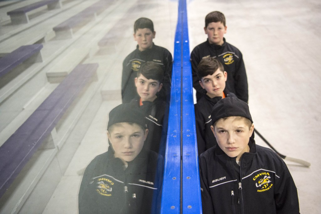 Bret Lambert, foreground, Cooper Tardiff, middle, and Adam Farrell all fought life-threatening birth defects to enjoy standout seasons for the Central Maine Youth Hockey Association's Tier IV Squirt team this winter.