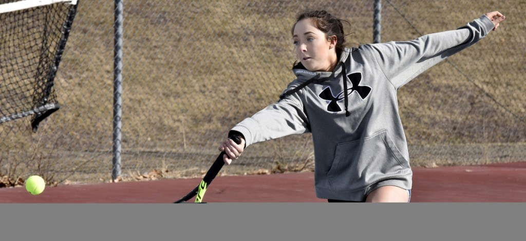 Erskine Academy's Anne-Marie Allen returns a shot during practice Wednesday in South China.