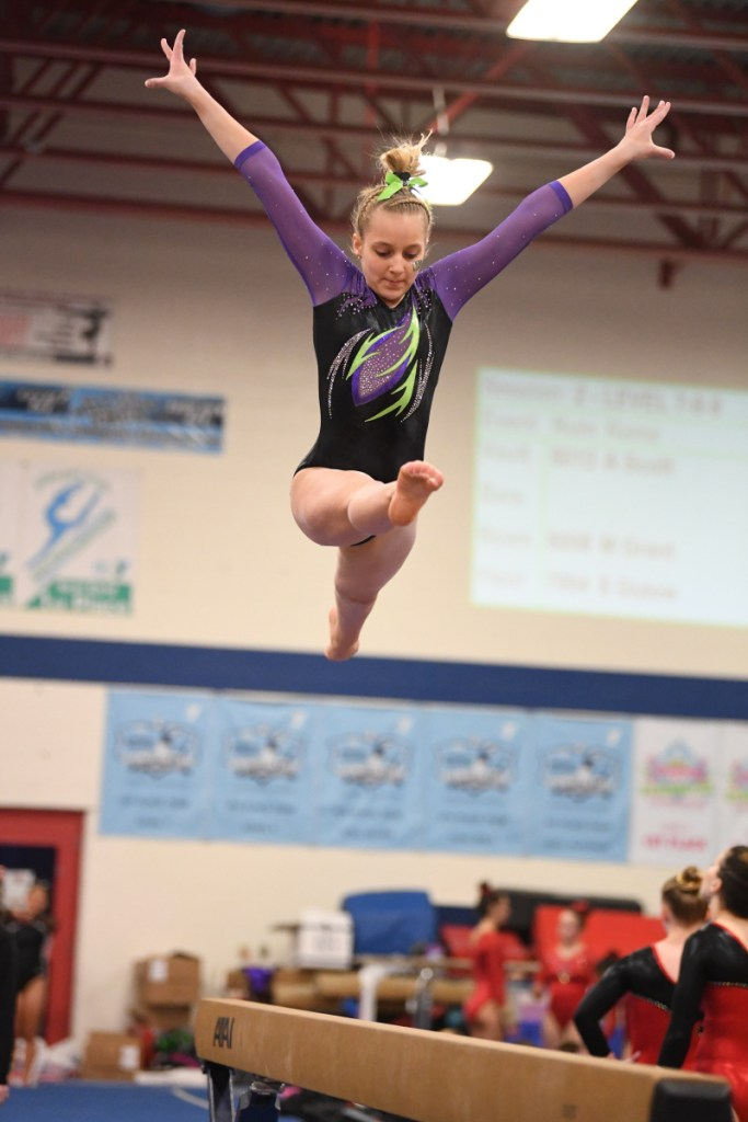 Erin Fontaine performs a routine on the bar.