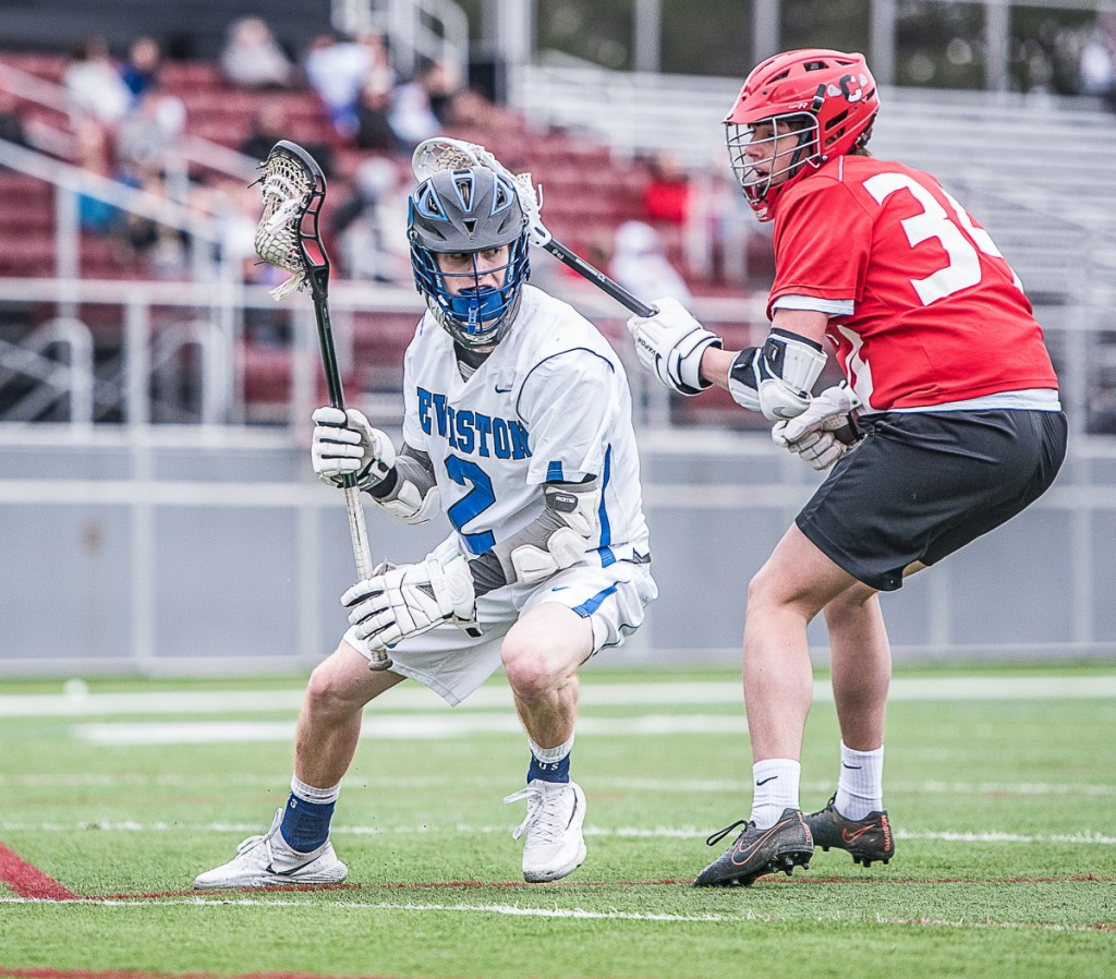 Sun Journal photo by Andree Kehnn Lewiston's Jayden Wilson controls the balls while Cony'sIan Bowers gives chase during Wednesday's lacrosse game in Lewiston.