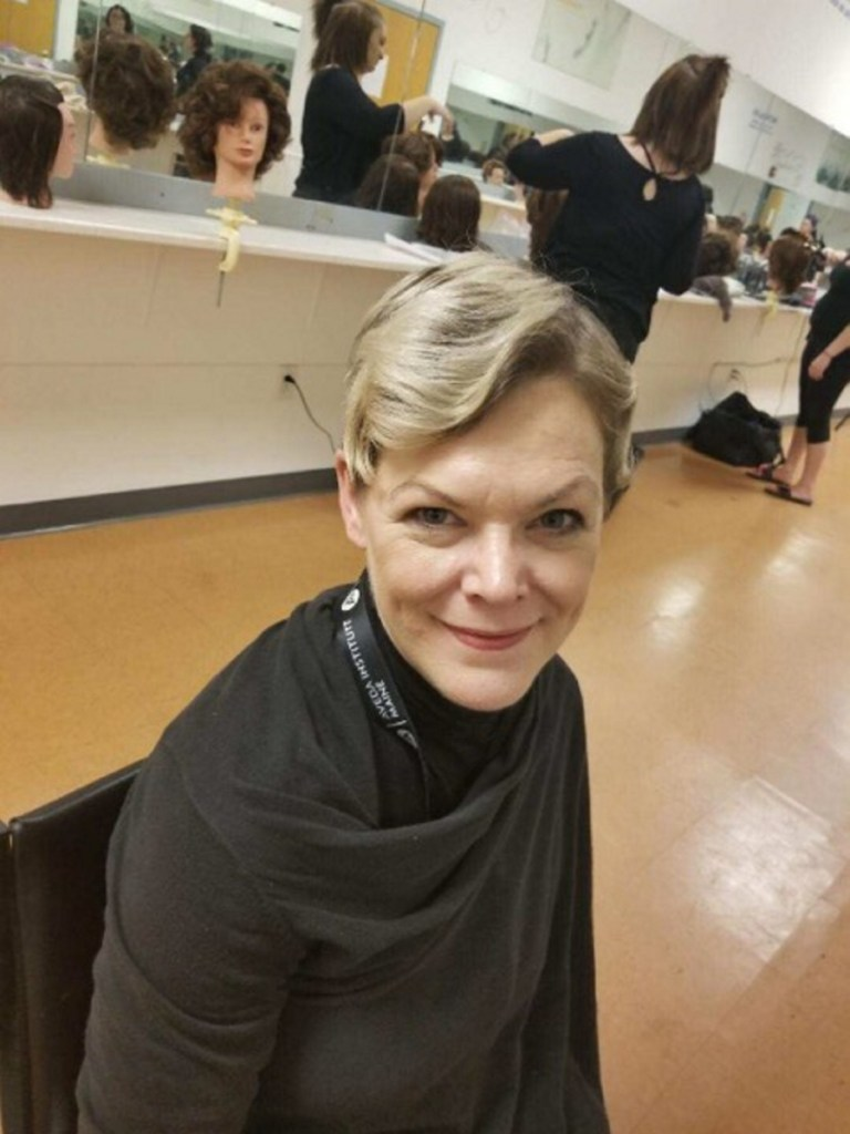 Kimberly Mironovas sits at a station at Aveda Institute Maine, a cosmetology school in Augusta. Mironovas, 47, was found dead early Sunday morning in her Litchfield home. Her son and another boy are charged with murdering her.