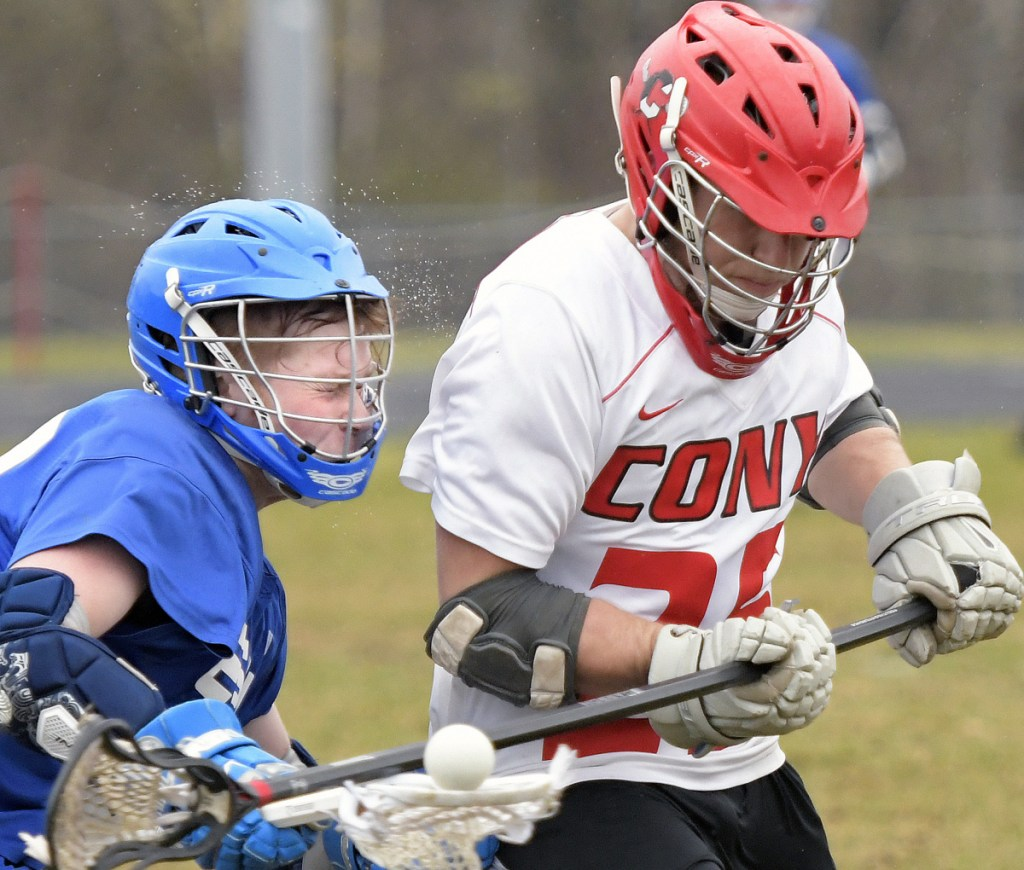 Cony's Nick Robinson, right, clips Erskine's Dakota Perkins during a lacrosse match Wednesday in Augusta.