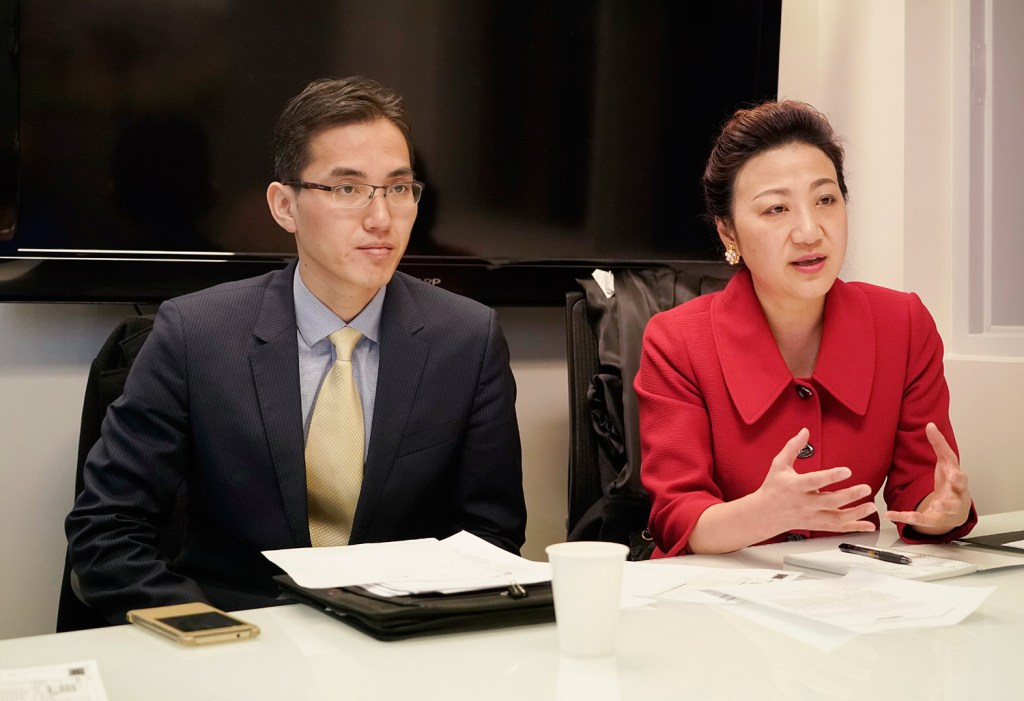 Jin Songbao, left, consul to the Consulate General of the People's republic of China in New York, and Meifang Zhang, deputy consul general, meet with reporters and editors Monday at the Portland Press Herald in South Portland.