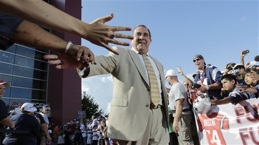 Former New England Patriots broadcaster Gil Santos is congratulated by fans as he walks the red carpet in Foxborough, Mass., on July 29, 2013. Santos and former linebacker Tedy Bruschi were inducted into the Patriots 2013 Hall of Fame.