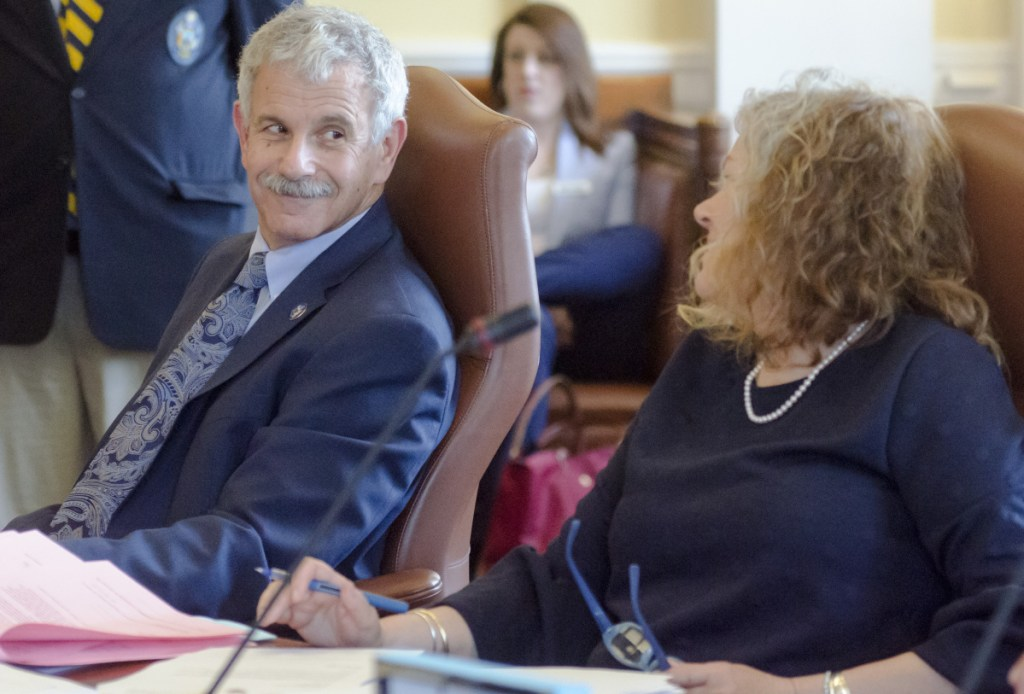 Republican Sen. Roger Katz, left, and Sen. Kimberly Rosen, R-Bucksport, members of the Legislature's Marijuana Law Implementation Committee, react Wednesday as the Senate votes to override Gov. Paul LePage's veto of the adult-use pot bill that came out of the panel.