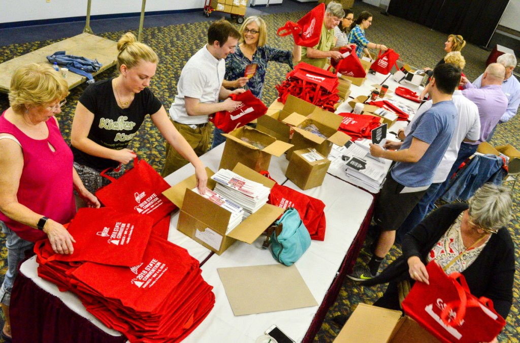 Volunteers stuff brochures into bags Thursday at the Augusta Civic Center in preparation for the last Republican state convention to be held during Gov. Paul LePage's tenure.