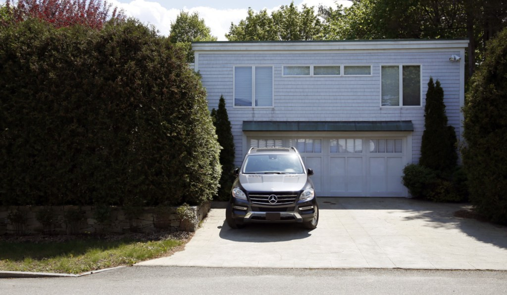 A Mercedes sits in the driveway of Stephen Mardigan's $985,000 home on Baxter Boulevard. An assistant U.S. attorney said he is not aware of a larger gambling-related case in Maine than Mardigan's in terms of the length of the operation and the total amount wagered. William Flynn was a player in  Mardigan's high-stakes gambling business in Portland from 2010 to 2017.