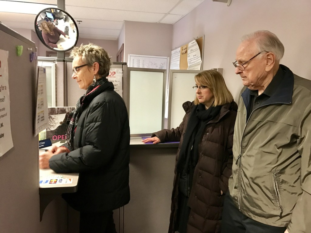 Former Waterville Mayor Karen Heck and residents Hilary Koch and Jim Chiddix take out paperwork April 9 at Waterville City Hall to start a petition to recall Mayor Nick Isgro. On Thursday, city officials certified they had gathered enough signatures to force a recall vote.