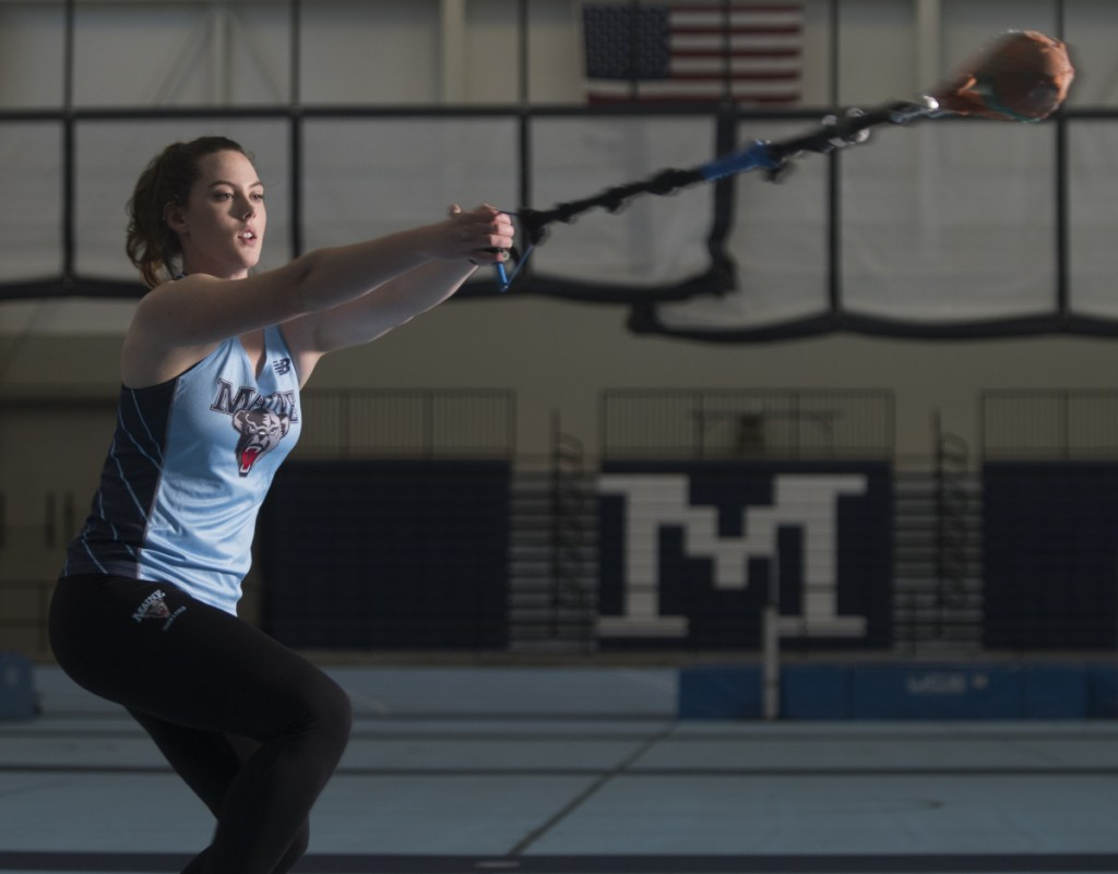 University of Maine senior and Waterville native Rachael Bergeron demonstrates her practice style in the field house in Orono. Bergeron won the America East Conference title in the hammer throw last week and will compete at the New England championship this weekend.