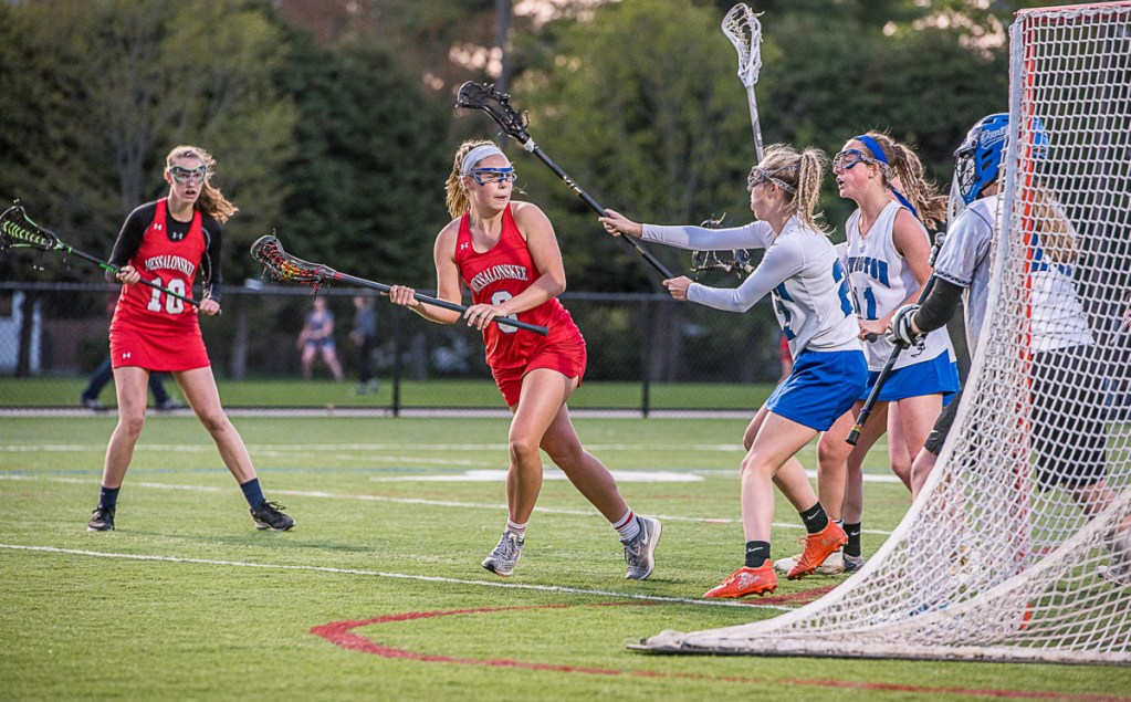 Messalonskee's Lauren Pickett looks for a hole in Lewiston's defense during Wednesday night's lacrosse game at Bates College in Lewiston.