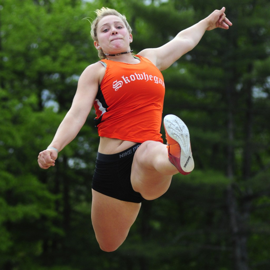 Skowhegan triple jumper Leah Savage gets some air during the Class A state track and field championships last season at Massabesic High School in Waterboro.