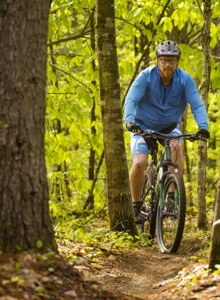 Thor Smith of Lewiston rides the new trails at Range Pond State Park.