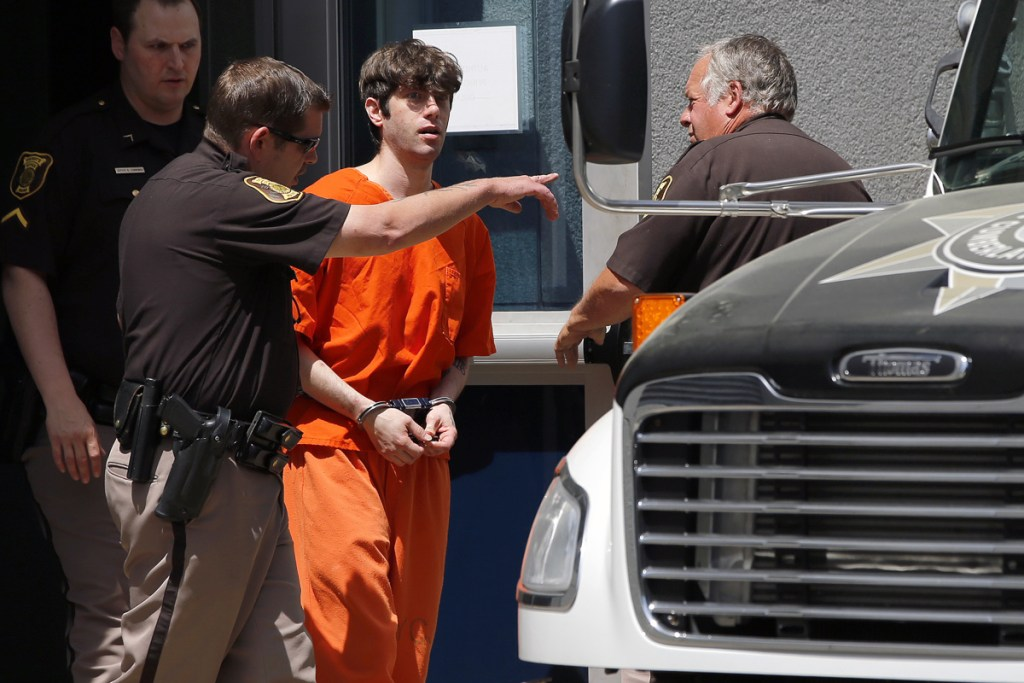 John D. Williams, who is accused of killing Somerset County sheriff's Cpl. Eugene Cole, is led out of the Cumberland County Courthouse on June 12 after pleading not guilty to murder.