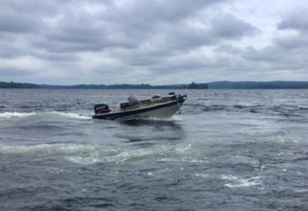 George F. Bonney's unmanned motorboat is seen moving in circles Thursday on Great Pond in Belgrade. Bonney's submerged body was discovered nearby.