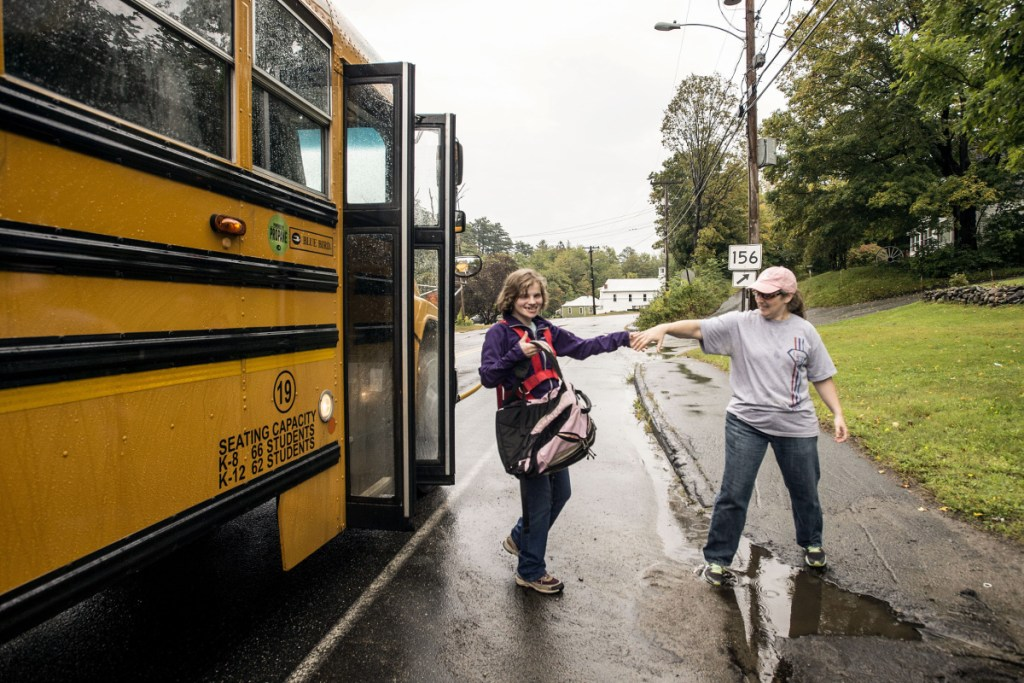 Siiri Stinson helps her daughter Leah off the bus Sept. 6, 2017, at the end of their driveway in Wilton. Leah requires 24-hour supervision. She received one-on-one care all day at school, was walked directly to her school bus and dropped off with her waiting mother. If Siiri was not at the driveway, the bus would continue on and return later until someone was there to receive Leah.
