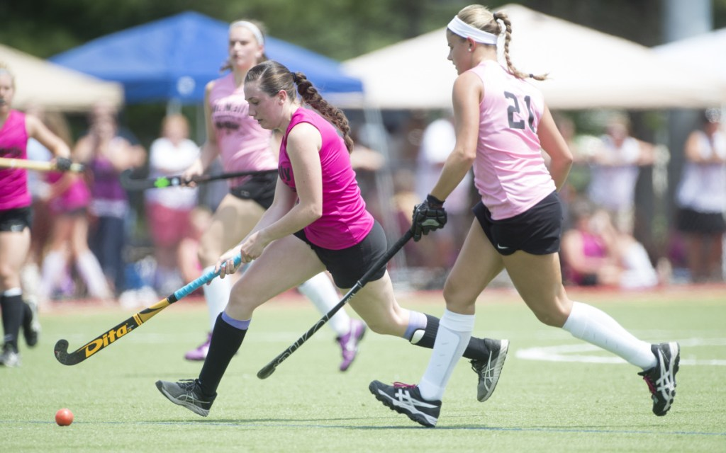 South All-Star Maddison LeBeau (21) chases North All-Star's Addi Williams in the  McNally Senior All-Star field hockey game Saturday at Thomas College in Waterville.