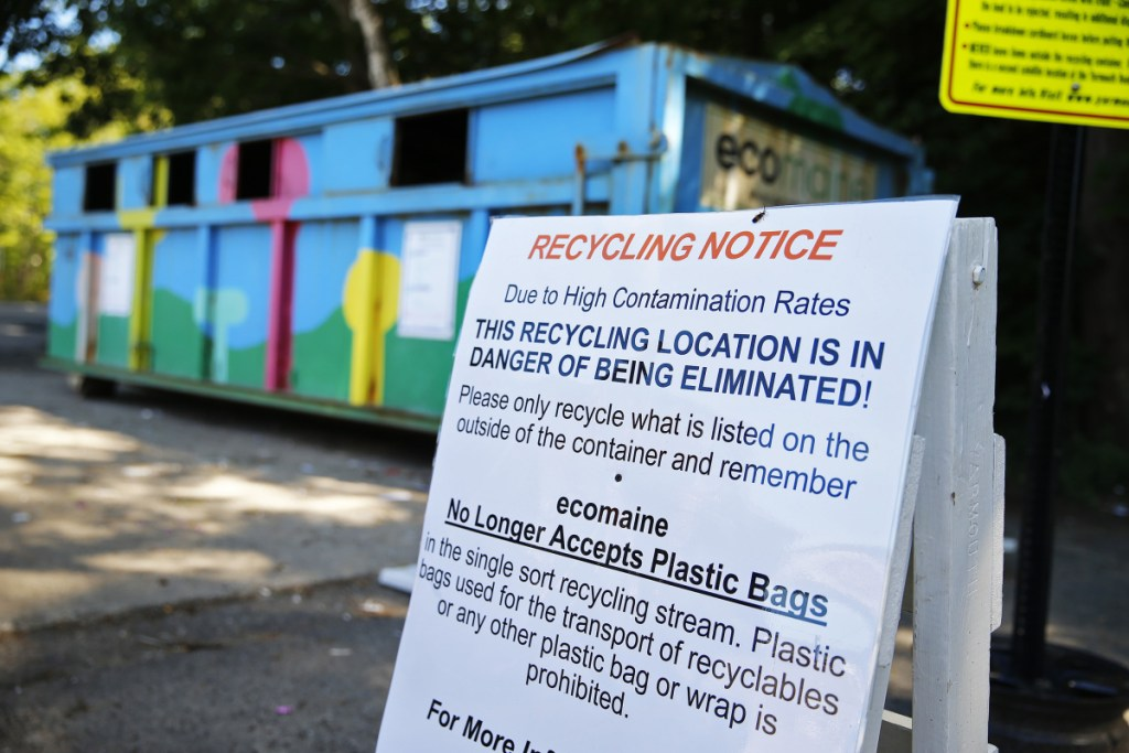 A sign posted by ecomaine in Yarmouth warns residents about the high contamination rates in the town's recycling, suggesting that this dropoff location could be in jeopardy of being eliminated.