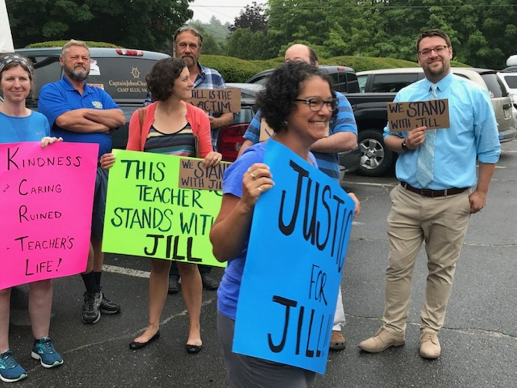 Teachers show their support for former Kennebunk High School health teacher Jill Lamontagne outside York County Superior Court in Alfred on Monday.