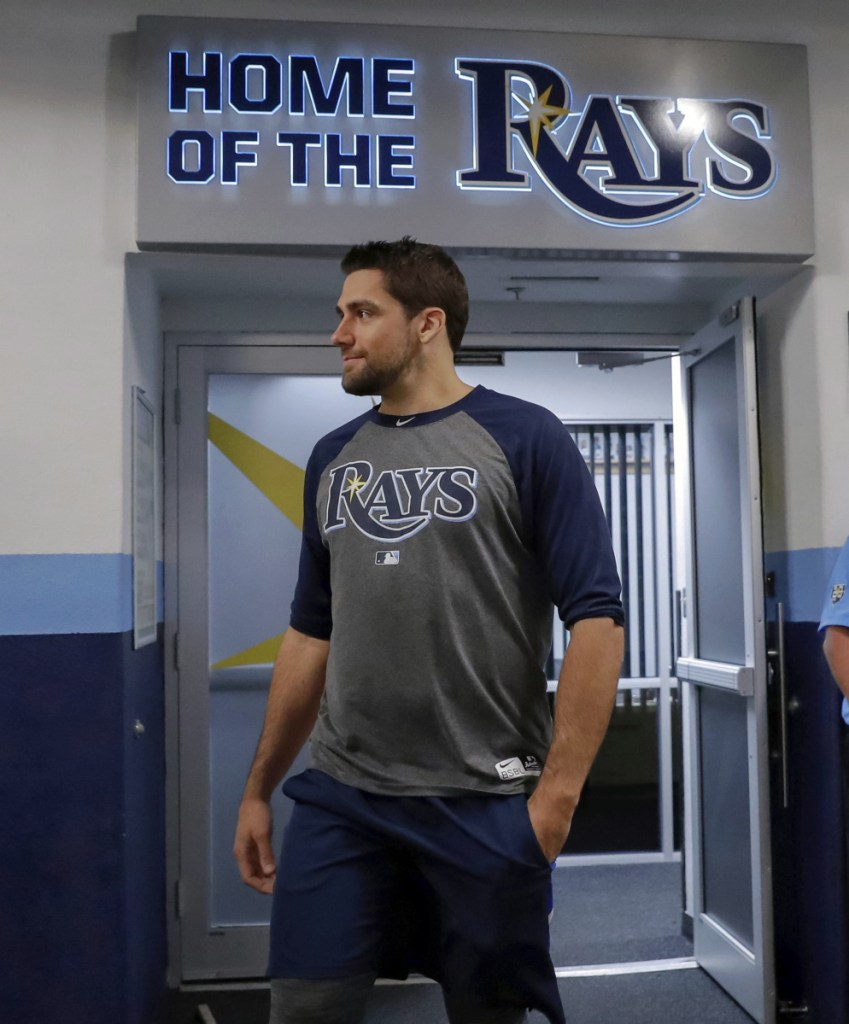 Nathan Eovaldi emerges from the Tampa Bay Rays' clubhouse after being traded to the Boston Red Sox on Wednesday. (AP Photo/Mike Carlson)