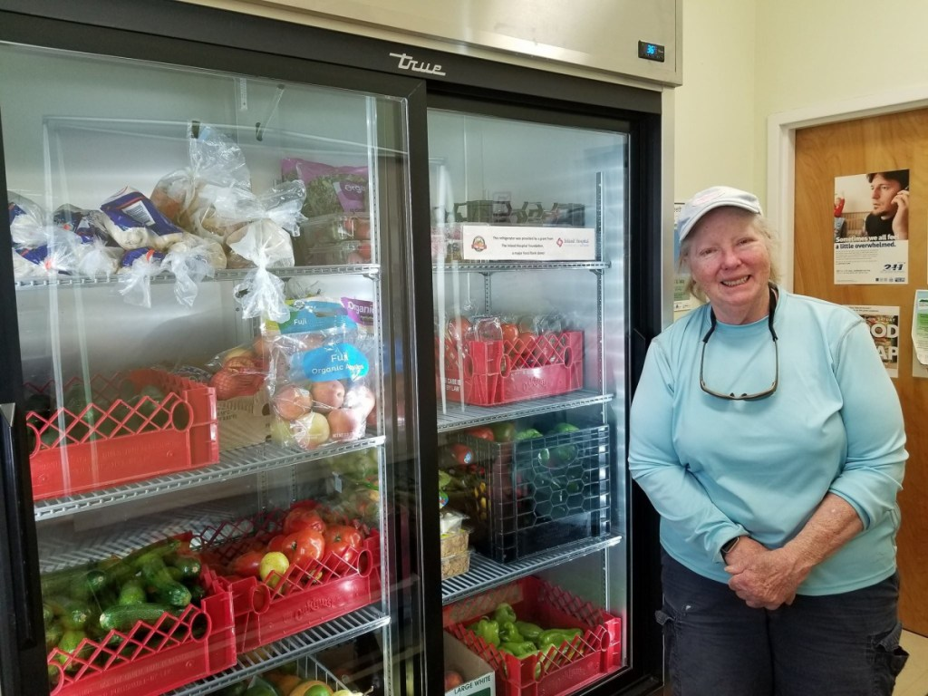 Sandy Hammond, operations manager of the Waterville Food Bank, with a new refrigerator donated by Inland Hospital's Community Benefit Grant Program.