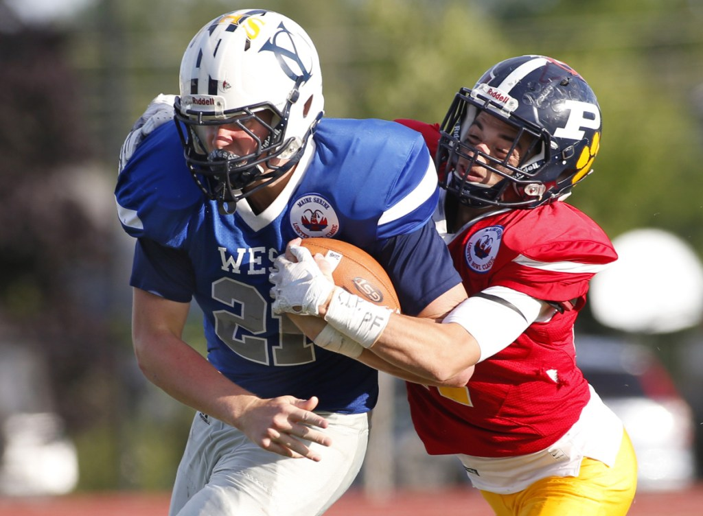 Vinnie Pasquali of Portland High School tackles West running back Jack True of Yarmouth in the fourth quarter during the Maine Shrine Lobster Bowl on Saturday in Saco.