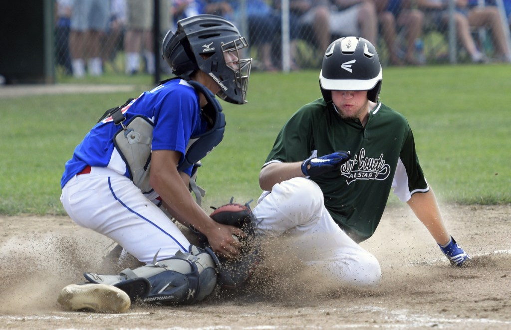 Augusta catcher Akira Warren tags Tri-County's Isaac Holland at home plate during the 13-15 New England Regional Babe Ruth tournament Monday in Augusta.