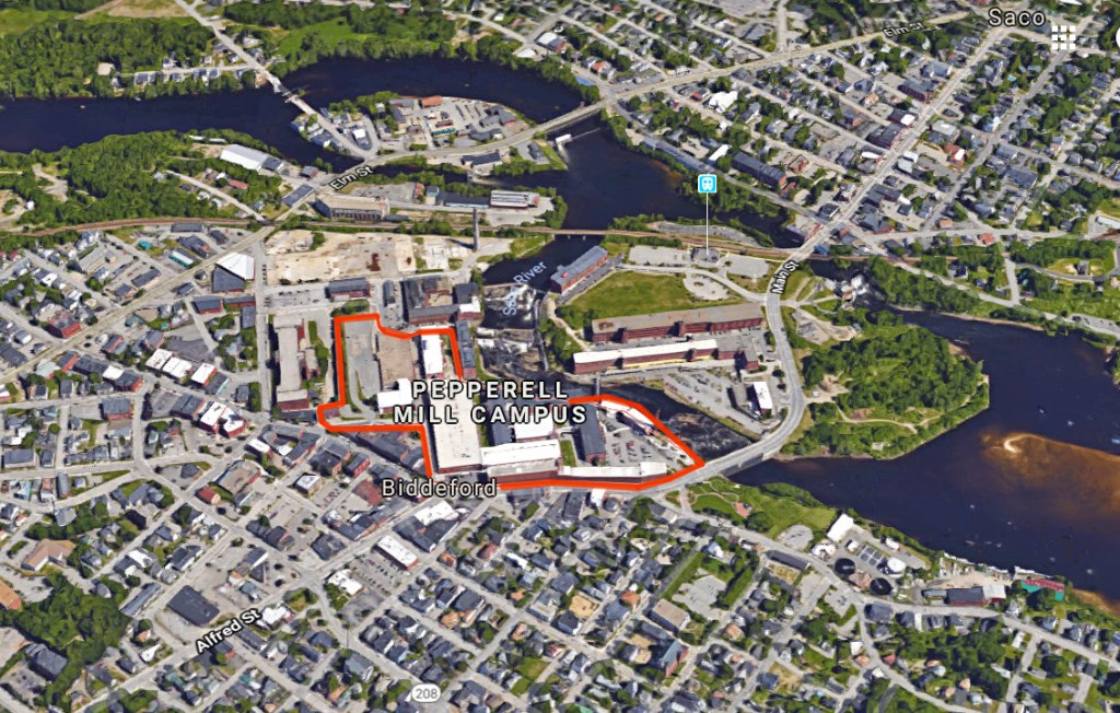 The Saco River flows past the former textile mills in Biddeford. The entire Pepperell Mill Campus, outlined here in red, includes 100 businesses.