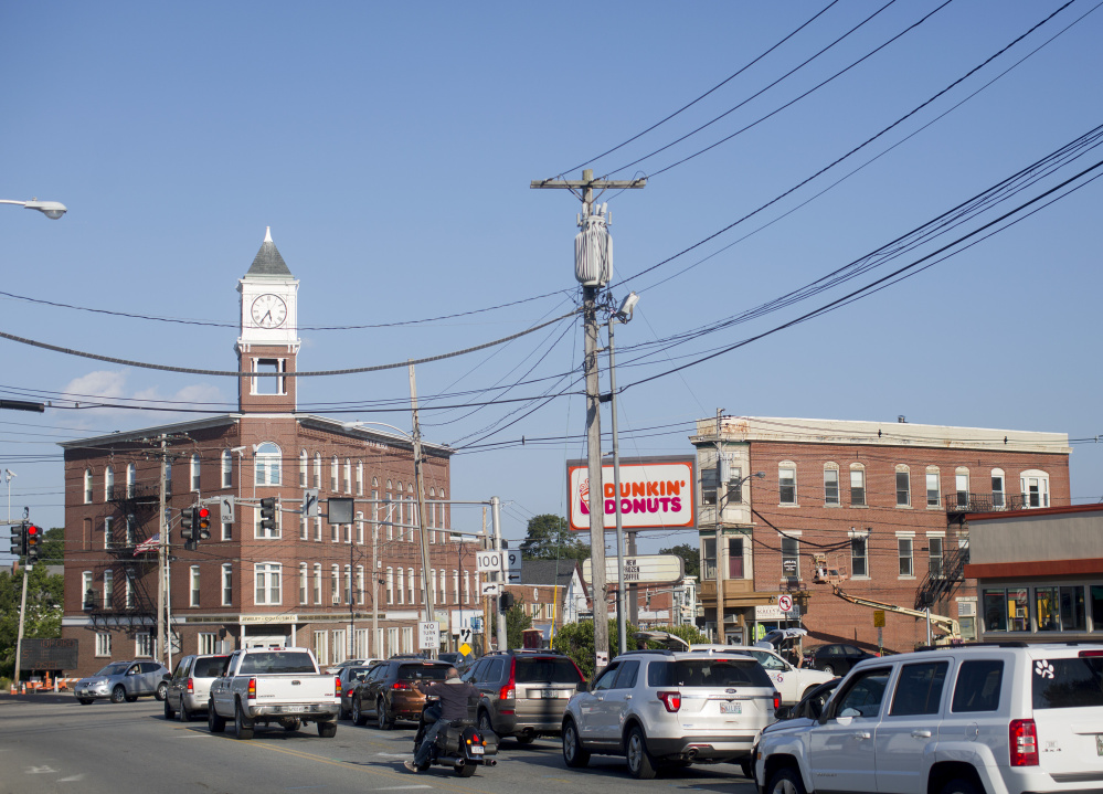 This view from Woodford Street shows Woodfords Corner, a five-way intersection, and its best-known landmark, the Odd Fellows Hall, at left with the clock tower.