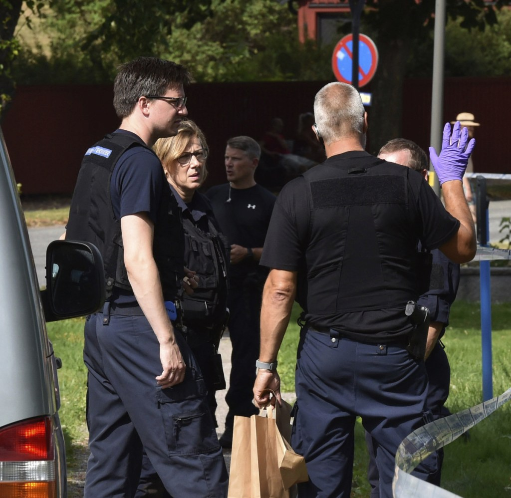 Police search for clues near Strangnas Cathedral, in Strangnas, Sweden. Police say thieves stole priceless treasures Tuesday from the Swedish royal regalia, above, and escaped by bicycle.