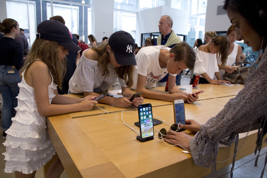 Customers browse in an Apple store in New York.