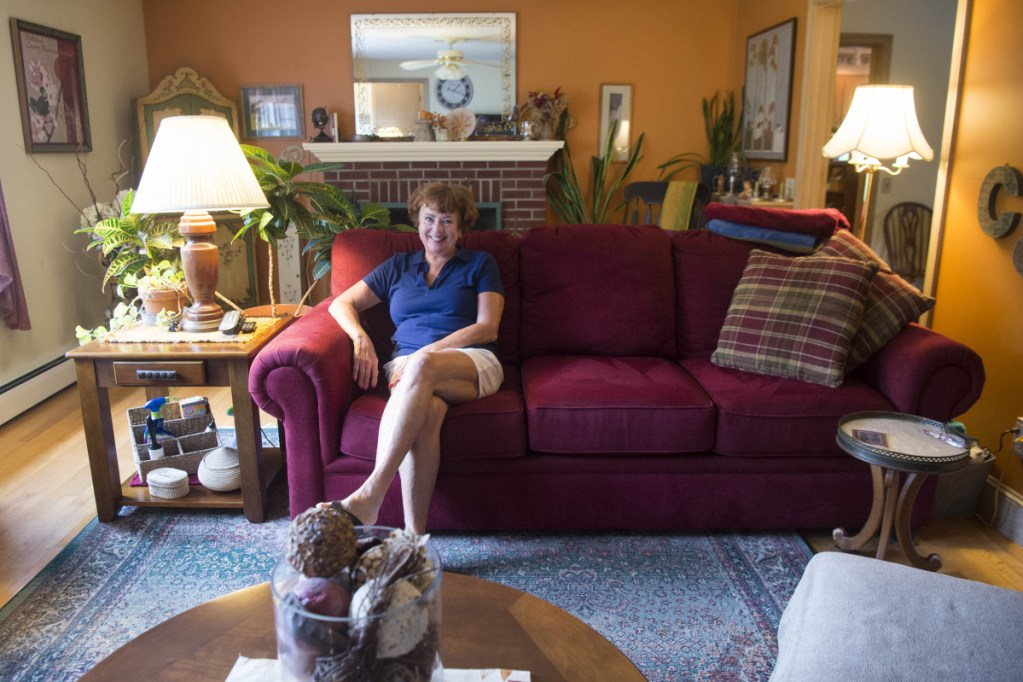 Cathy Taylor shows her home which is up for sale on Merrill Street in Waterville on Saturday.