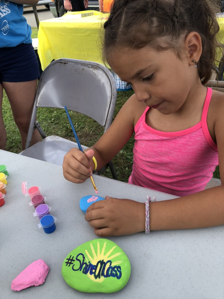 Avery Charland, of Fairfield, was among hundreds of kids who painted positive messages on rocks to hide in the community to spread kindness as part of the July 28 ShineOn Oakland Day at Oakfest.