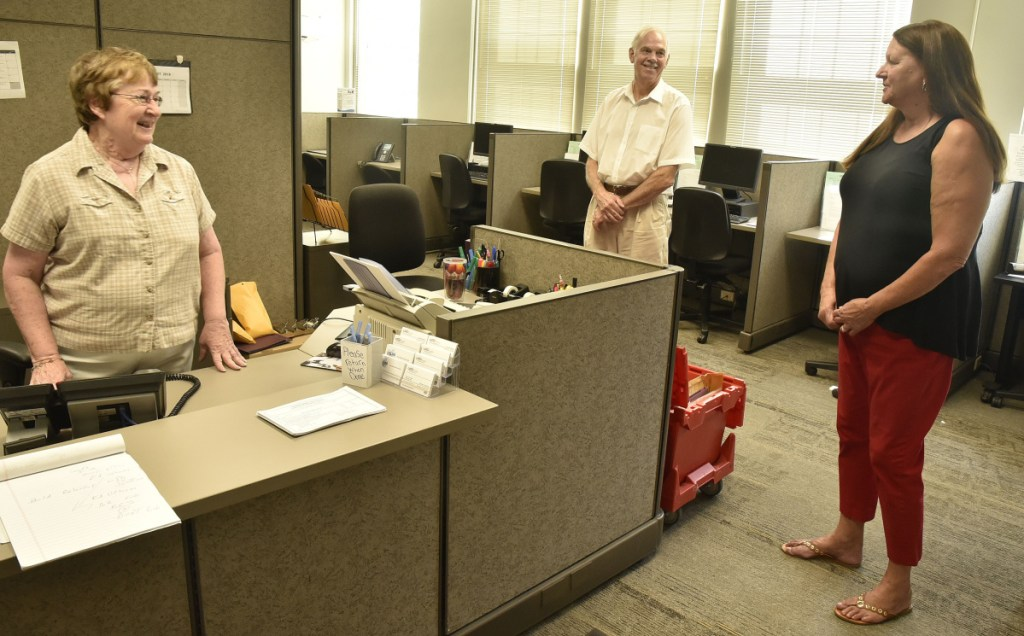 The Somerset Career Center has moved from Skowhegan into the Averill building on the Alfond Campus of Kennebec Valley Community College at Good Will-Hinckley in Fairfield, where it was open for business on Monday. Rita Chaykowsky, left, of the Associates for Training and Development agency, speaks with counselor Mike Shirley and Assistant Director Linda Price.