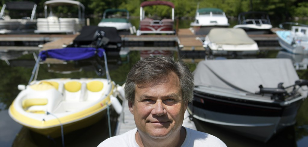 Shawn Grant on the docks July 16 at Brightside Marina, the business he owns in Belgrade Lakes Village. Grant is appealing the denial of a commercial business permit for the marina he has operated for 10 years on Hulin Road.