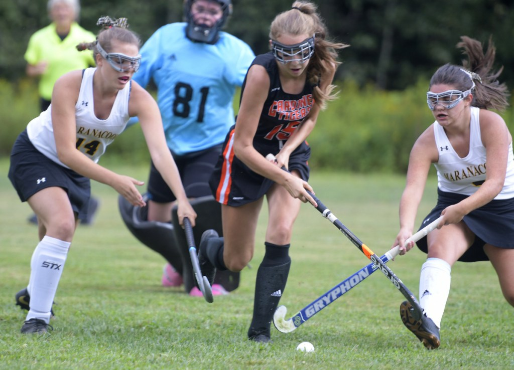 Maranacook's Abigail Whitcomb, right, and Haylee Weeks, left, pursue Gardiner's Maggie Bell during a game Thursday in Readfield.