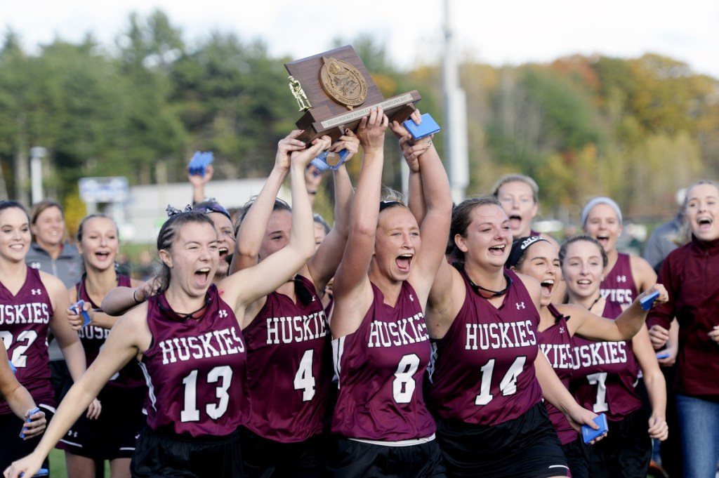 The MCI field hockey team celebrates after winning the Class B state championship last season over York at Falmouth High School.