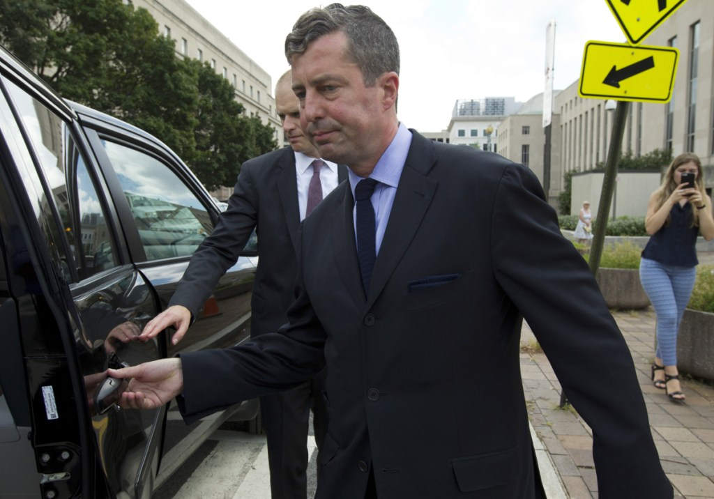 W. Samuel Patten leaves the federal court Friday in Washington. Patten entered a guilty plea in federal court in Washington, shortly after prosecutors released a four-page charging document that accused him of performing lobbying and consulting work in the United States and Ukraine but failing to register as a foreign agent as required by the Justice Department.