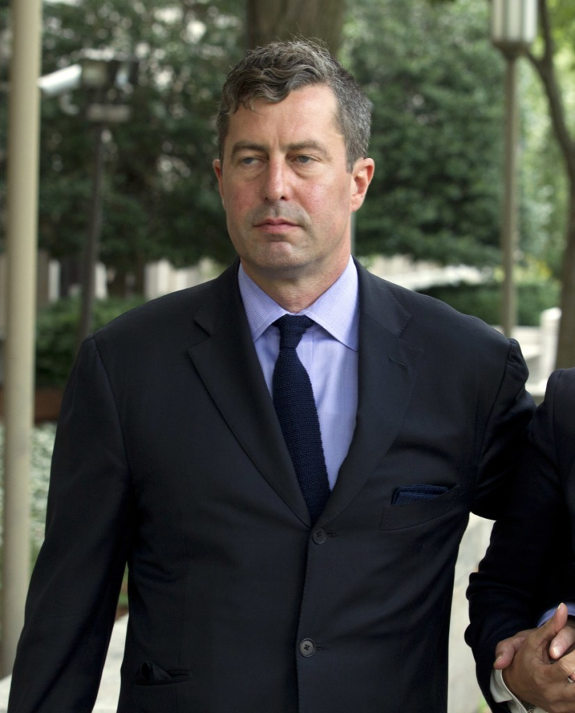 W. Samuel Patten leaves the federal court Friday in Washington.