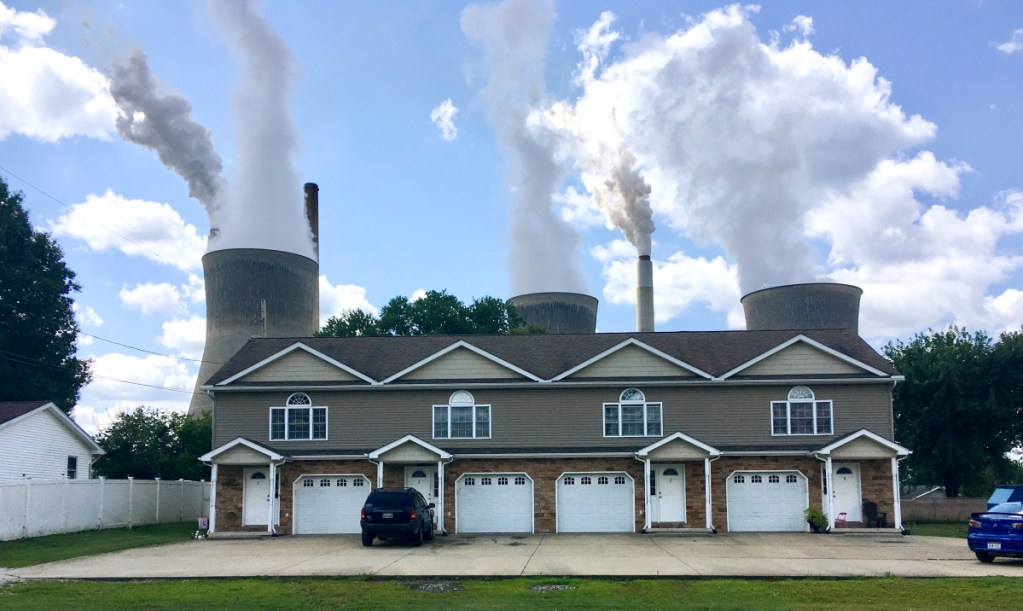 An apartment building stands in the shadow of American Electric Power's coal-fired plant in Winfield, W.Va. An EPA analysis says the health of West Virginia residents will be hit hard if Obama-era pollution controls are rolled back.