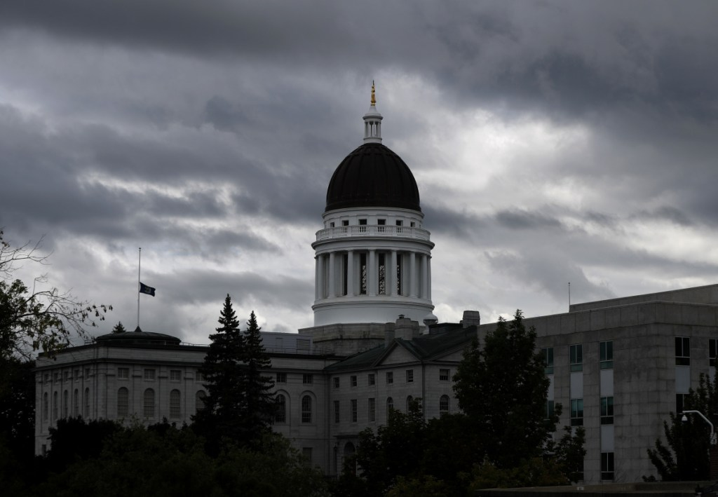 Associated Press/Robert F. Bukaty The Maine State House is seen last month in Augusta. Term limits and voter reaction to two non-candidates in the upcoming elections – President Trump and Gov. LePage – could play an outsized role in 2018's State House races.