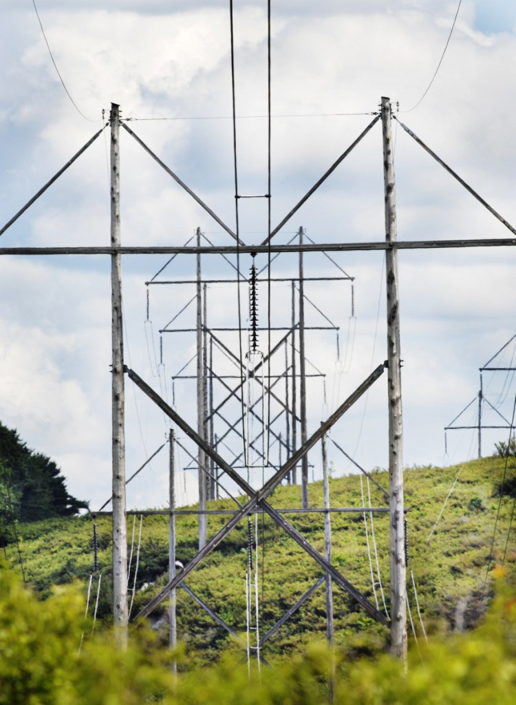 These 345-volt transmission lines cross U.S. Route 201 in Topsham. Hearings on CMP's proposal to build a 145-mile transmission line from Quebec to Lewiston will be held Friday at the University of Maine in Farmington and The Forks Town Hall.
