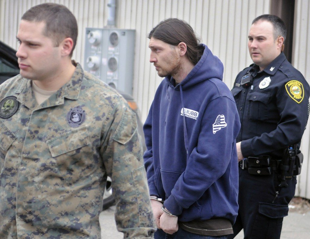 Augusta police officers escort Donald Morang on March 24, 2016, to a police cruiser after arresting him at his Augusta apartment on drug-trafficking charges.