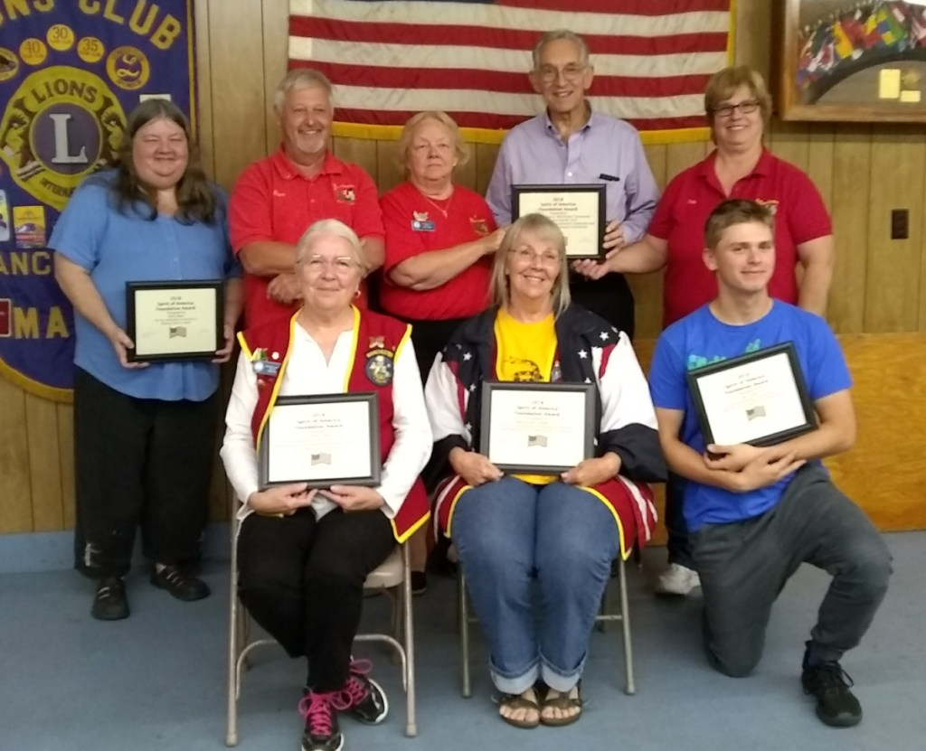 The Manchester Lions recently presented its Spirit of America award, from left are Linda Cobb, Carolyn Van Horn and John Lauter. In back, from left, are Ruth Short, Manchester Spirit of America organizer and emcee David Worthing, Arlene Gagnon, Leon Strout and Debbie Maddox.