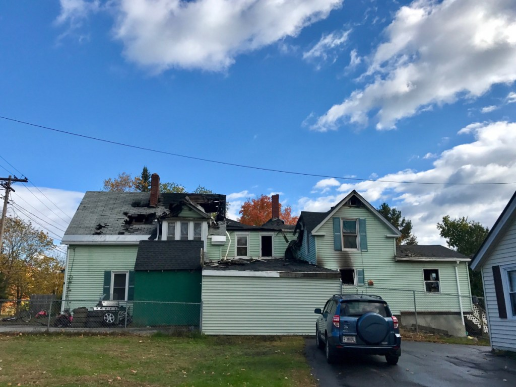 Damage can be seen on the side walls and roof of a duplex at 16 Winter St. in Fairfield that the Fairfield Fire Department said was destroyed early Saturday morning.