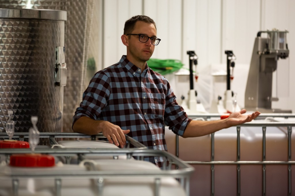 Nathan Hall, co-owner of Kennebec Cider Company stands in the brewing building while providing a tour of the facility. Hall explained the brewing process and methods of the company on Saturday prior to the start of the third annual Ciderfest on Saturday in Winthrop.